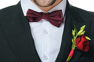 groom in suit with boutonniere