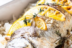 Fish seabass baked with rice and vegetables.