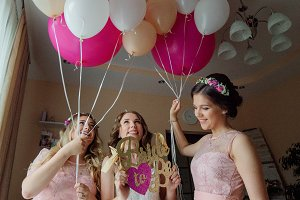 Bride and bridesmaids in pink dress
