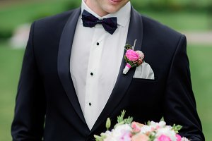 Stylish groom in black suit