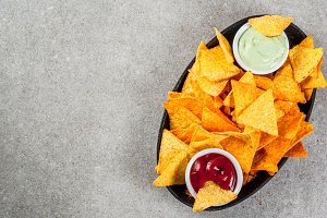 Nachos with ketchup and guacamole