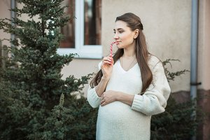 pregnant woman  in nature in autumn