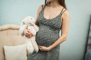 pregnant girl with toy rabbit