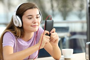 Relaxed teenager wearing headphones