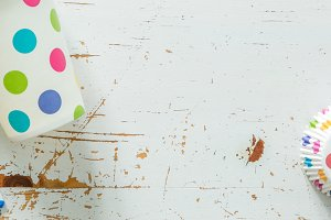 Birthday decorations on white wood background