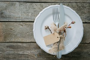 Easter table setting on rustic background