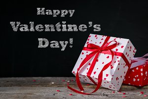 Valentine's day concept - presents, on rustic wood background