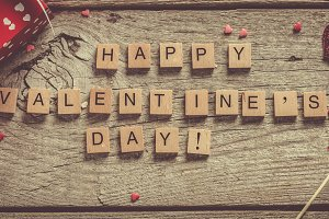 Valentine's day concept - presents, candy, glasses on rustic wood background