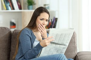 Worried woman reading bad news