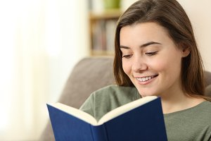 Teen reading a paper book