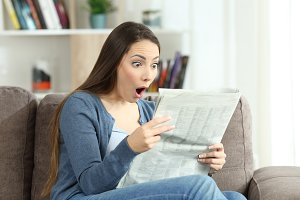 surprised woman reading amazing news