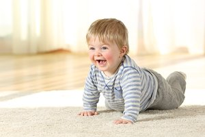 Portrait of a happy baby crawling