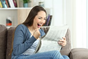 excited woman reading good news