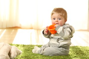 distracted baby biting a toy