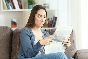 confused woman reading absurd news