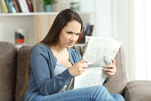 angry woman reading bad news