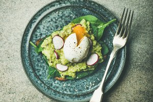 Healthy vegetarian gluten-free breakfast avocado toasts, square crop