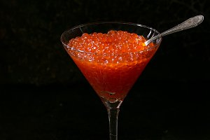 Glass of red caviar