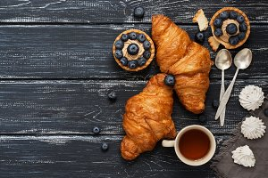 Croissants and cake with blueberries