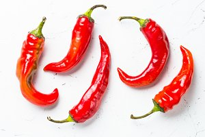 Red hot chilli pepper on white.