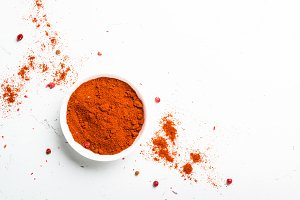 Ground pepper, peppercorn and fresh chili pepper on white
