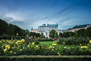 Burgtheater at sunset, view from Volksgarten in Vienna