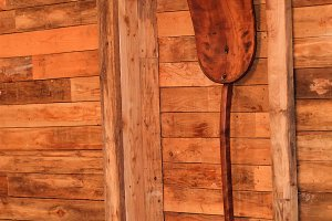 Wood shovel on cottage wooden wall