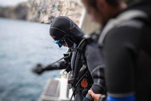 Scuba diver preparing on boat