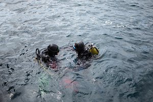 Two scuba divers in water
