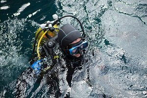 Cheerful diver in water