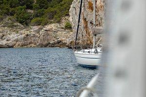 Boat sailing at rock