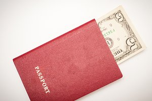 Passport with money on white background