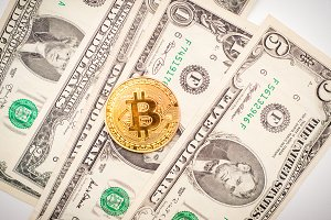 Bitcoin with money on white background