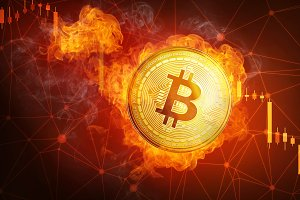 Golden bitcoin coin falling in fire flame.