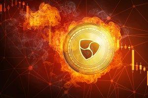 Golden NEM coin falling in fire flame.