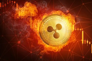 Golden Ripple coin falling in fire flame.