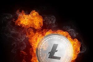 Golden Litecoin coin falling in fire flame.