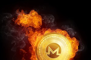 Golden Monero coin falling in fire flame.