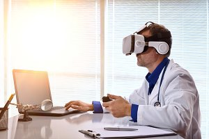 Doctor with laptop and vr glasses