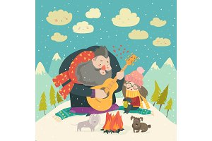 Boy plays guitar for a girl in the winter forest