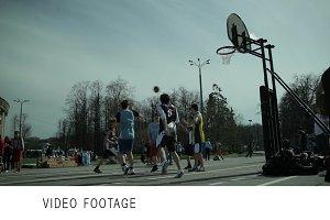 Teenagers playing basketball 1