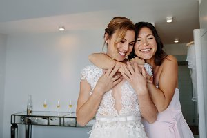 Happy bridesmaid giving a tender hug