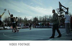 Teenagers playing basketball 2