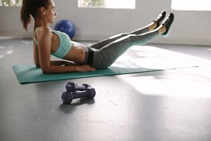 Fit woman doing stretching exercise