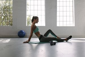 Woman relaxing at fitness club