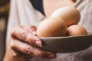Woman with Bowl of Free Range Eggs