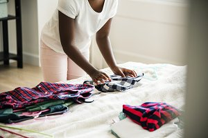 Girl helping with folding the clothe