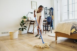Girl sweeping up the floor