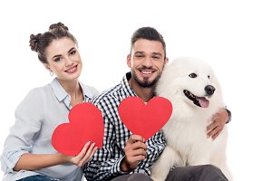 happy couple with samoyed dog