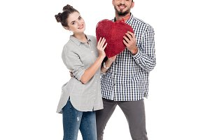 couple holding heart of threads